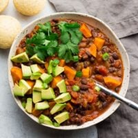 square image of chili, grey background