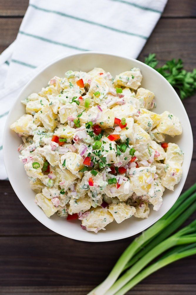 vegan potato salad in a white bowl