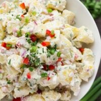 close up of vegan potato salad in white bowl