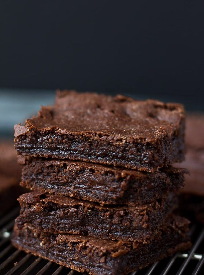 Stack of vegan brownies with black background.