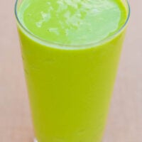 A tropical green smoothie with a handful of healthy ingredients.