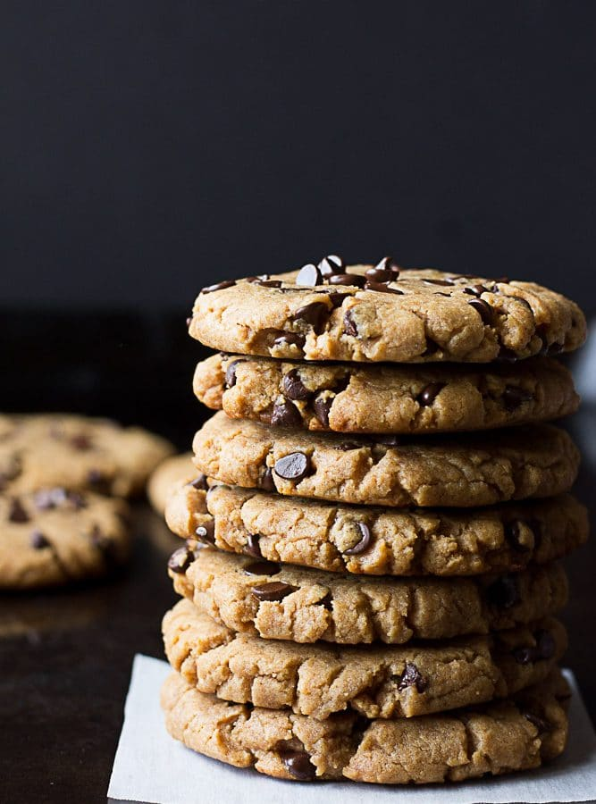 tall stack ofOil Free Peanut Butter Chocolate Chip Cookies