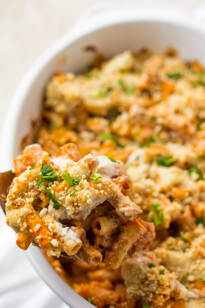 vegan baked ziti on a large spoon out of casserole dish