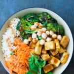 Peanut Buddha Bowl with chewy, crispy tofu and roasted broccoli.