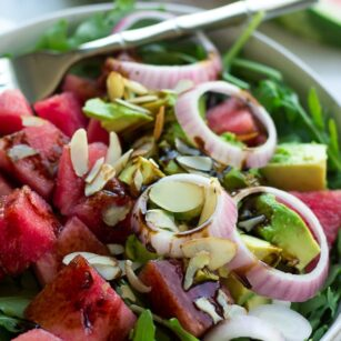 looking down on a photo of watermelon arugula salad