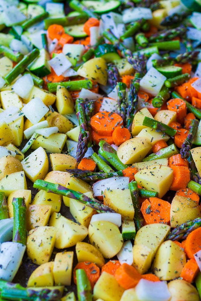 A mix of yukon gold potatoes, asparagus, carrots, zucchini and onions.