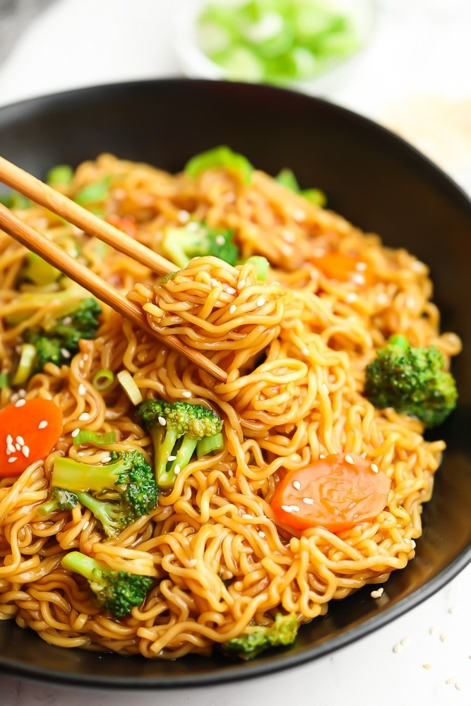 chopsticks picking up noodles from bowl