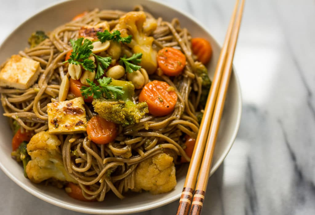Vegan Teriyaki Noodle Bowls with vegetables and baked tofu