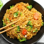 square image of a black bowl filled with Asian noodles