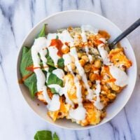 Buffalo Cauliflower Buddha Bowl- Roasted Buffalo Cauliflower, brown rice, spinach, chickpeas and cashew cream.
