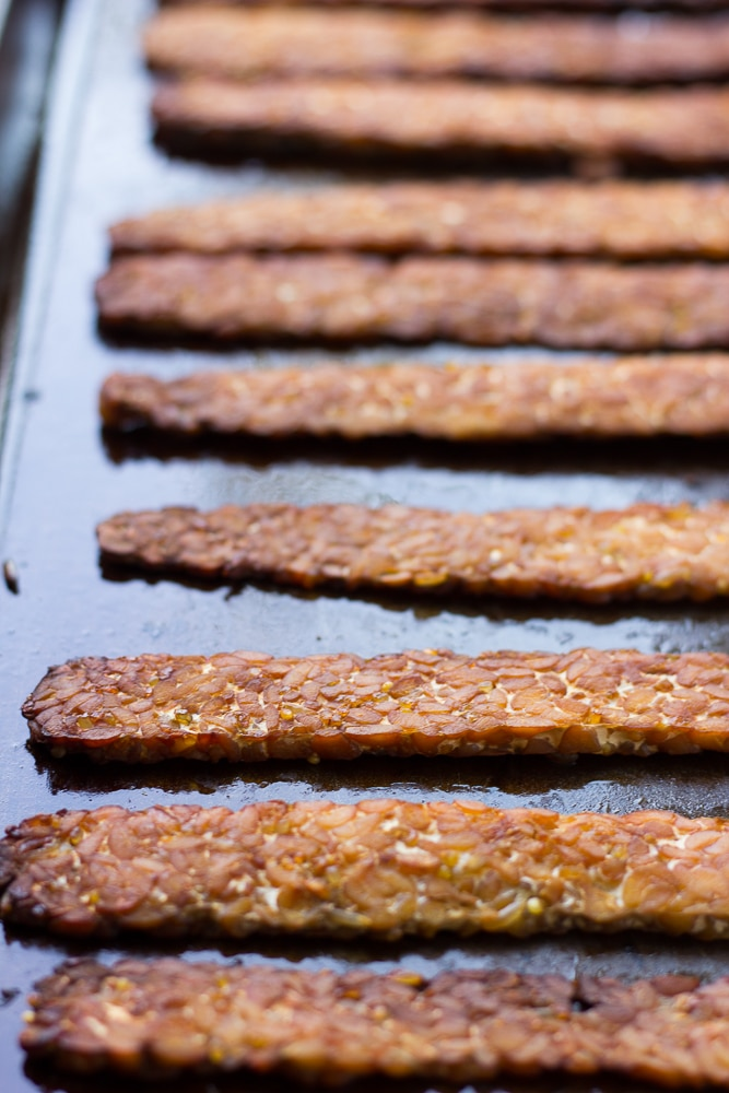 baked tempeh bacon on a pan