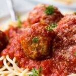 close up of vegan meatball on top of spaghetti