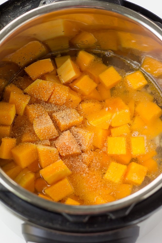 making vegan butternut squash soup, squash in pot.