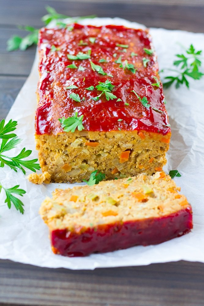 vegan meatloaf on a wooden board with parsley