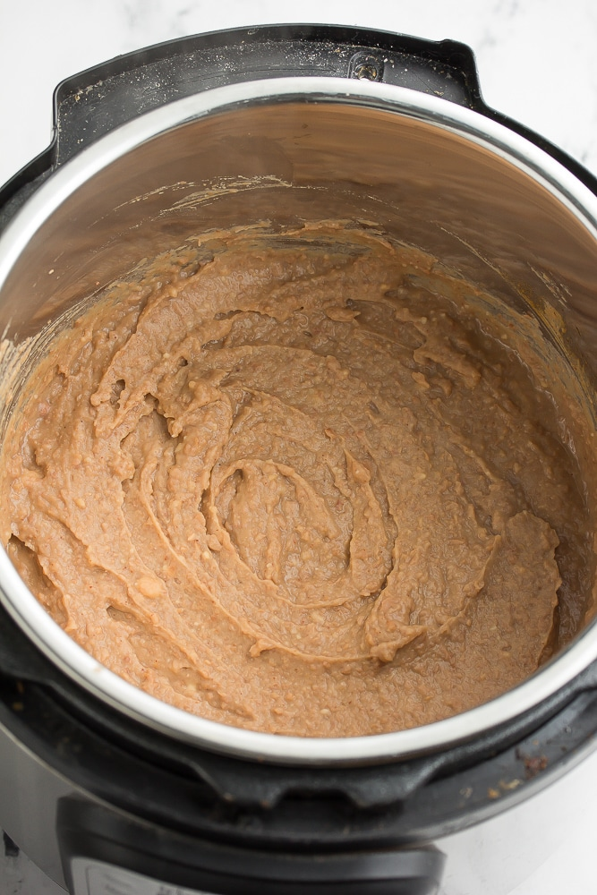 instant pot pan full of smooth refried beans