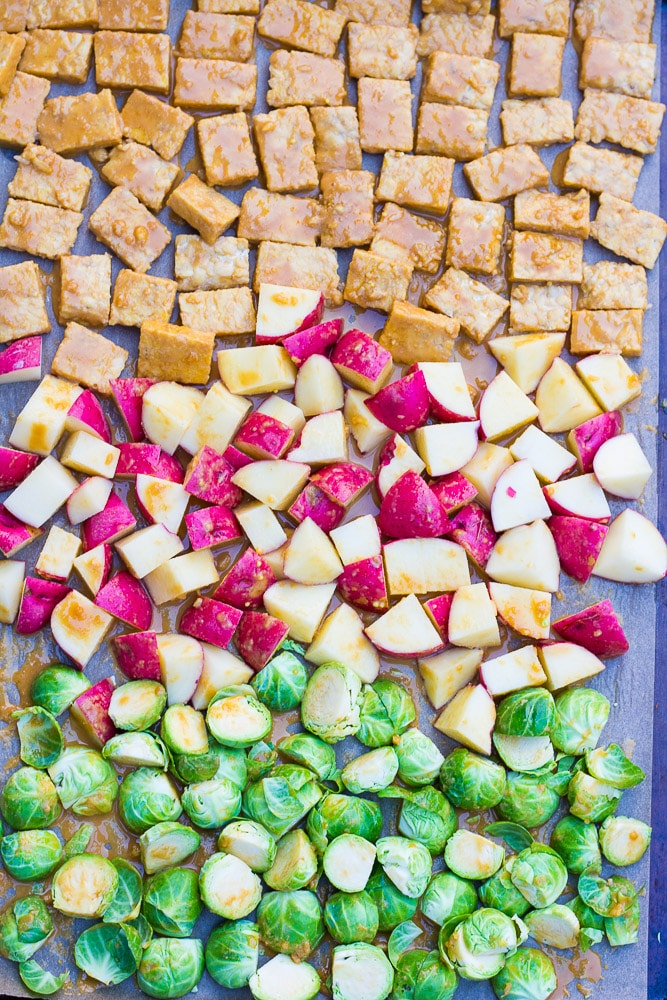 A one-pan meal with marinated tempeh, red potatoes and brussels sprouts.