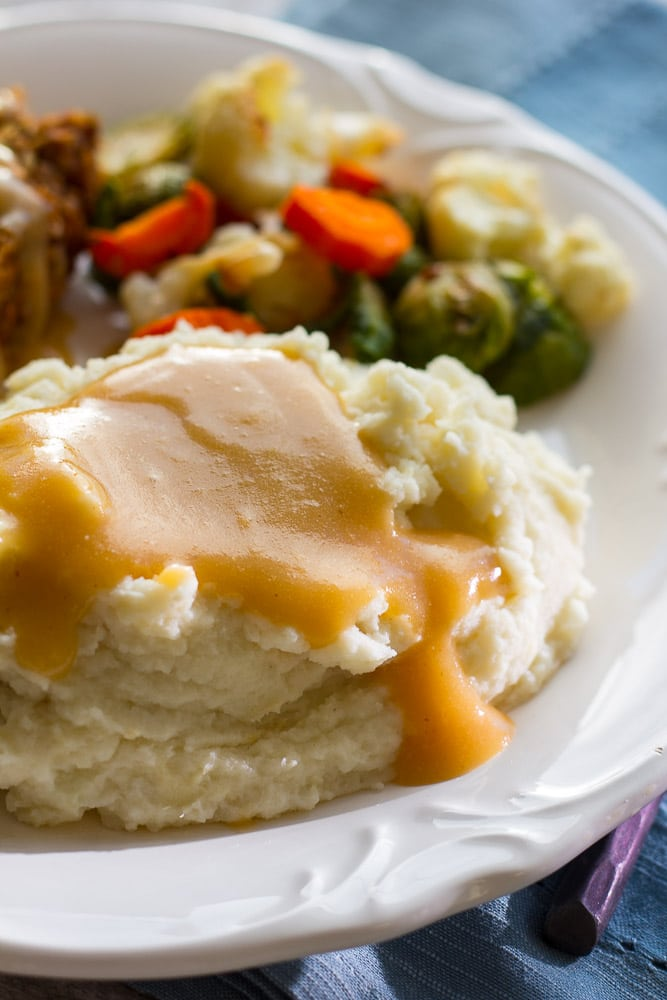 Easy Vegan Gravy on a pile of mashed potatoes
