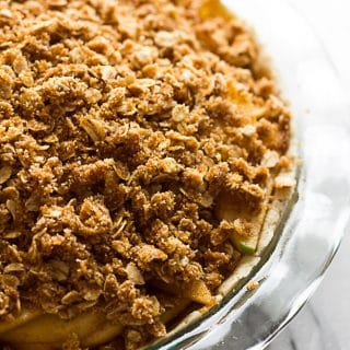 Gluten Free Vegan Apple Crumble Pie: Made with an almond flour crust, minimal oil, and full of sticky sweet apples with a perfect crumble topping.