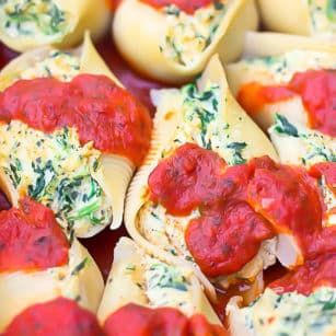 square image of stuffed shells in dish