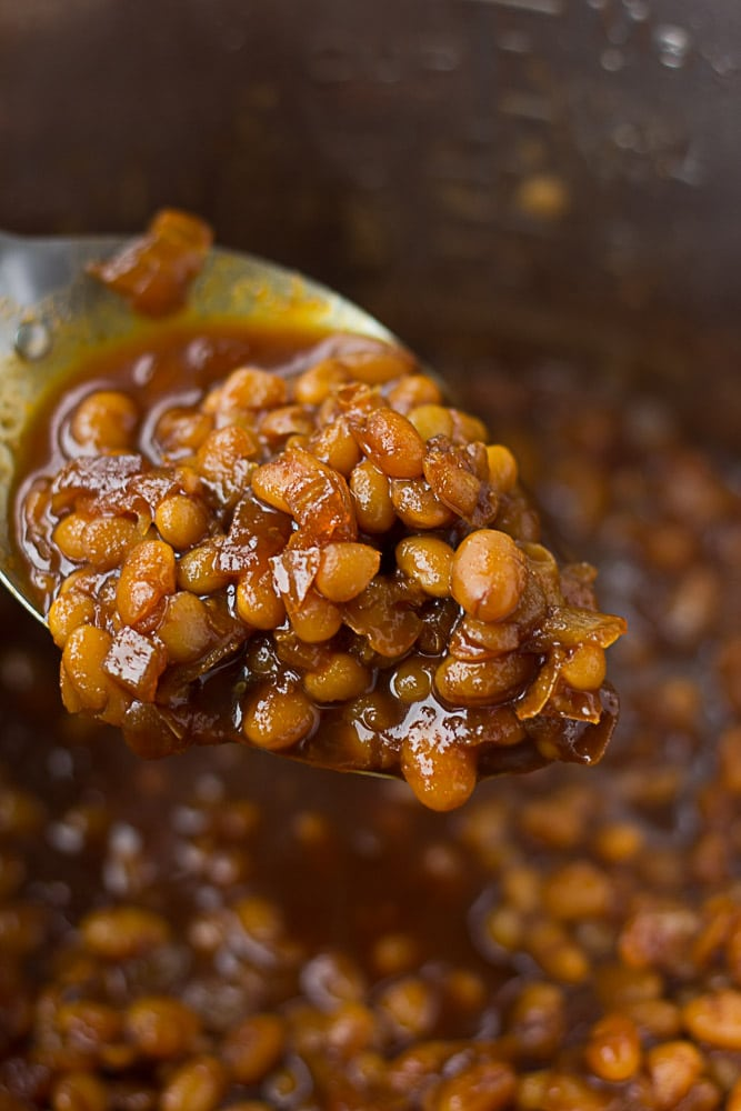 vegan baked beans in instant pot on a spoon