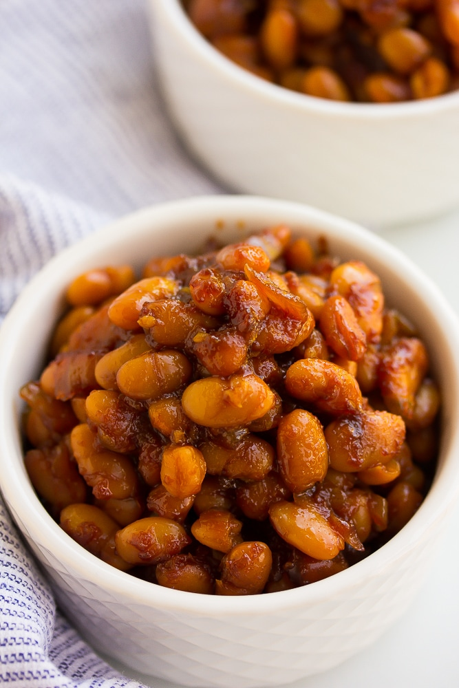 side shot of baked beans in white bowls