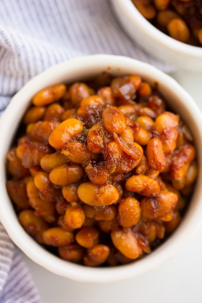 close up of vegan baked beans in a white bowl