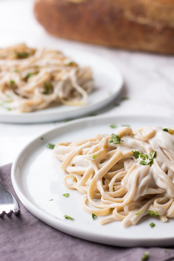 vegan alfredo with fettucine on two plates