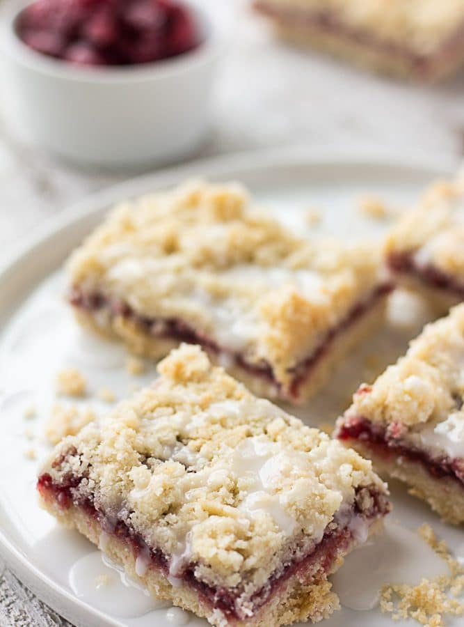 raspberry bars on a plate