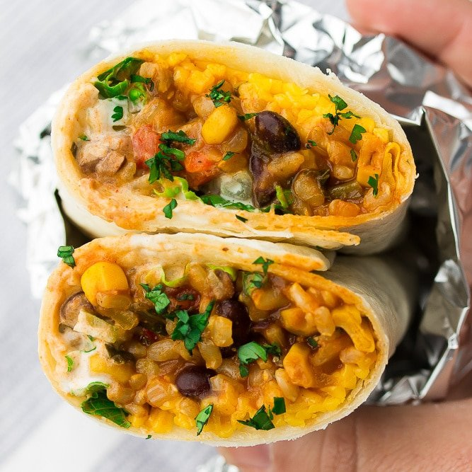 square image of vegan burrito wrapped in foil