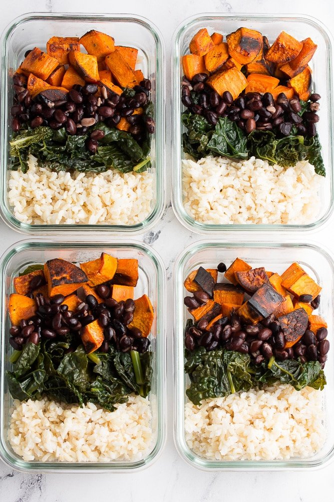 no creamy sauce on glass containers with beans, sweet potatoes, kale and rice