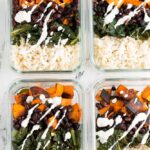 4 containers of vegan meal prep with creamy sauce