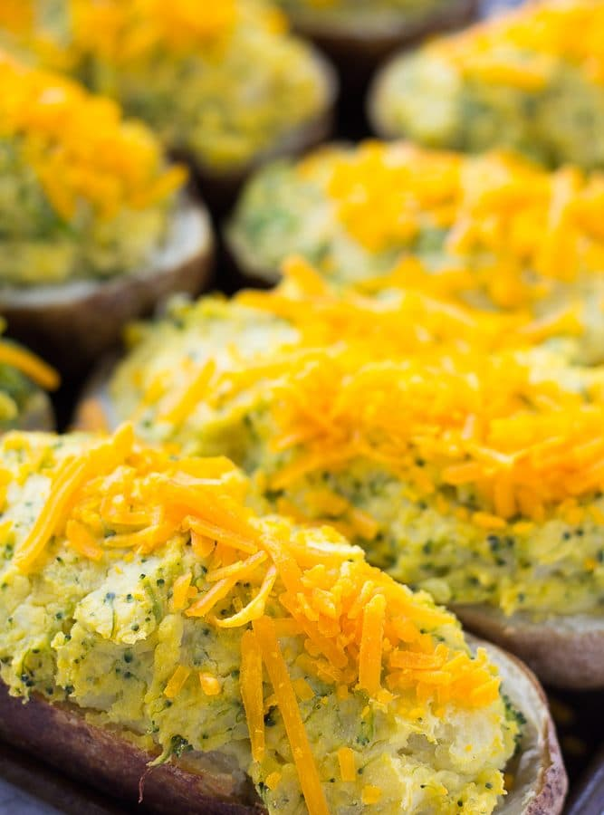 close up of several vegan cheesy twice baked potatoes