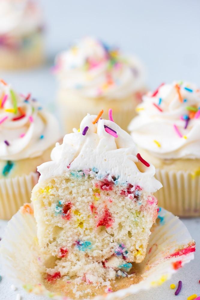 a funfetti vegan cupcake cut showing the middle
