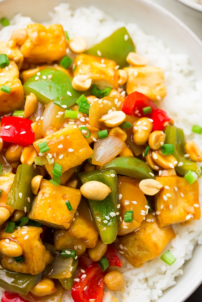 tofu and peppers and peanuts over rice