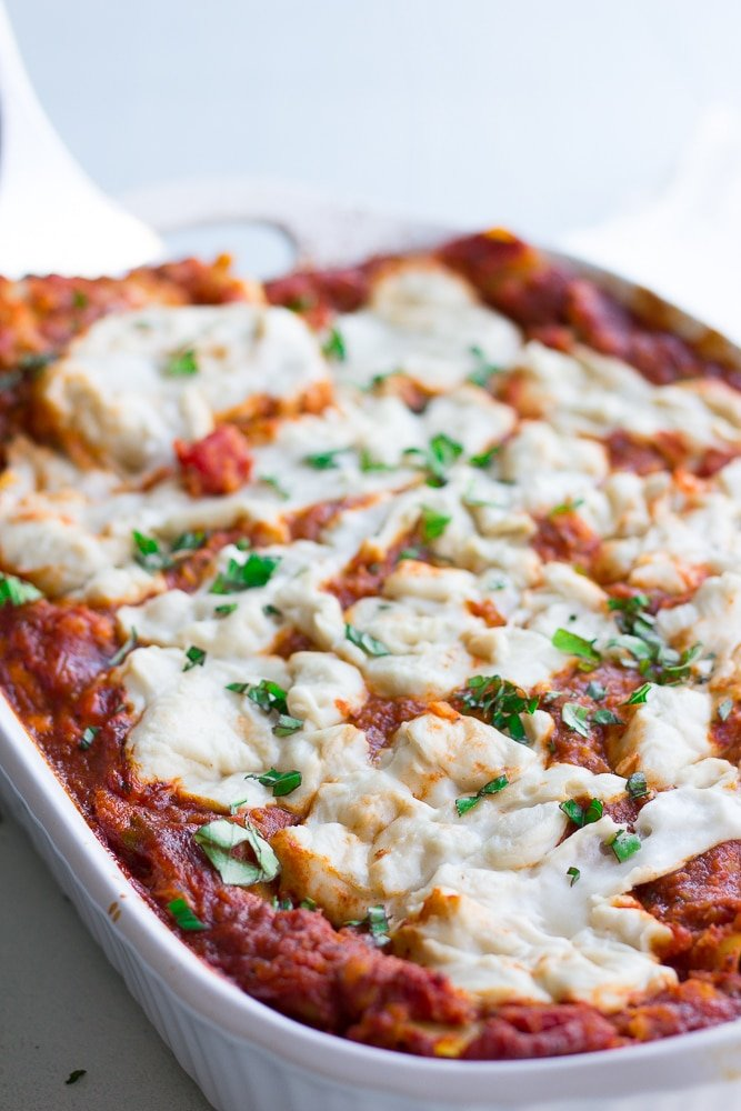 vegan lasagna in a casserole dish from side shot