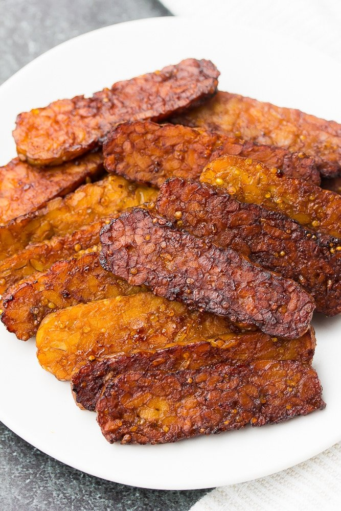 plate with pile of tempeh bacon on it