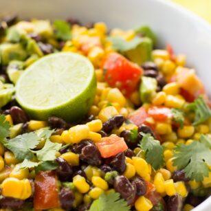 close up photo of black bean corn avocado salad