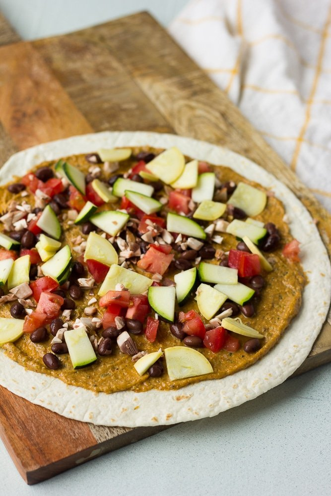 vegan quesadilla with toppings being added