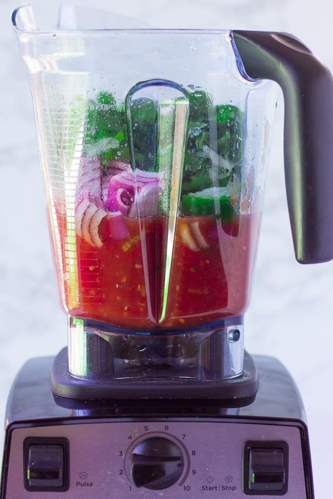 showing ingredients for salsa in blender before blending.