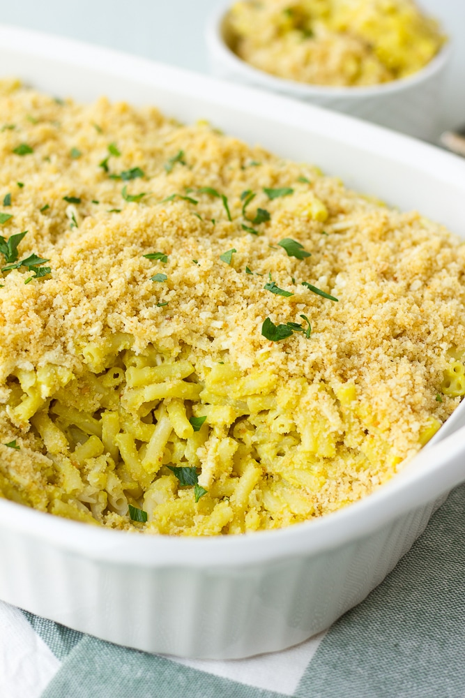 vegan mac and cheese recipe baked version in casserole dish with breadcrumb topping