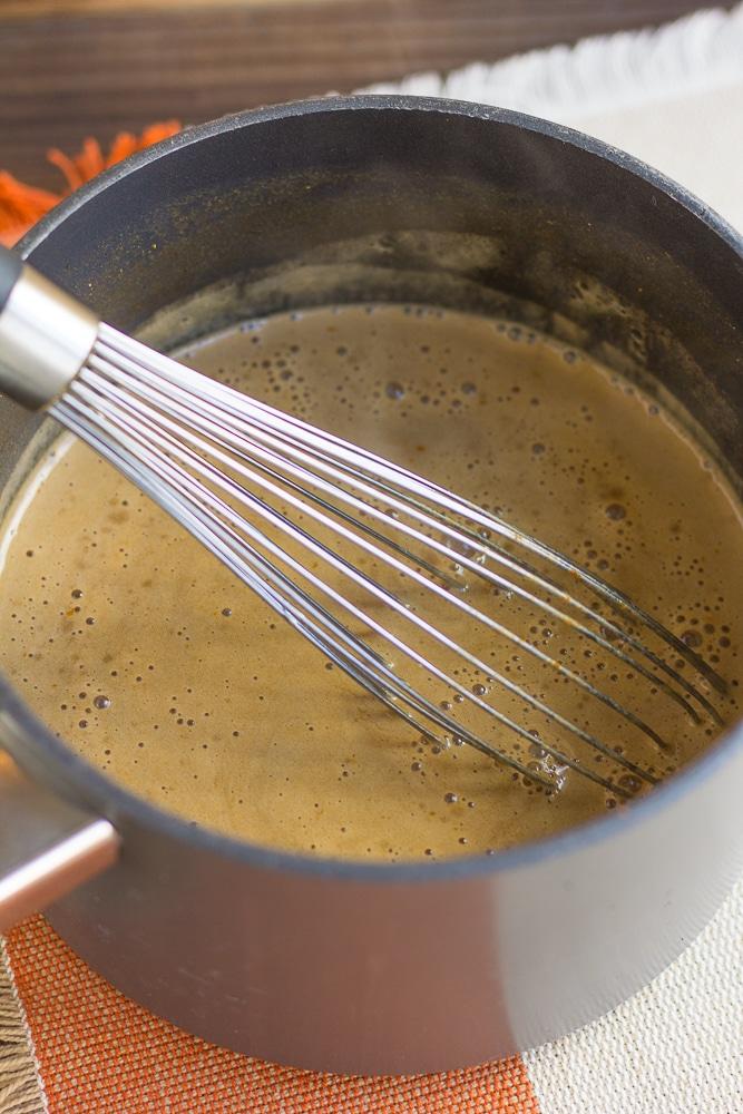 pumpkin spice latte being warmed in pot