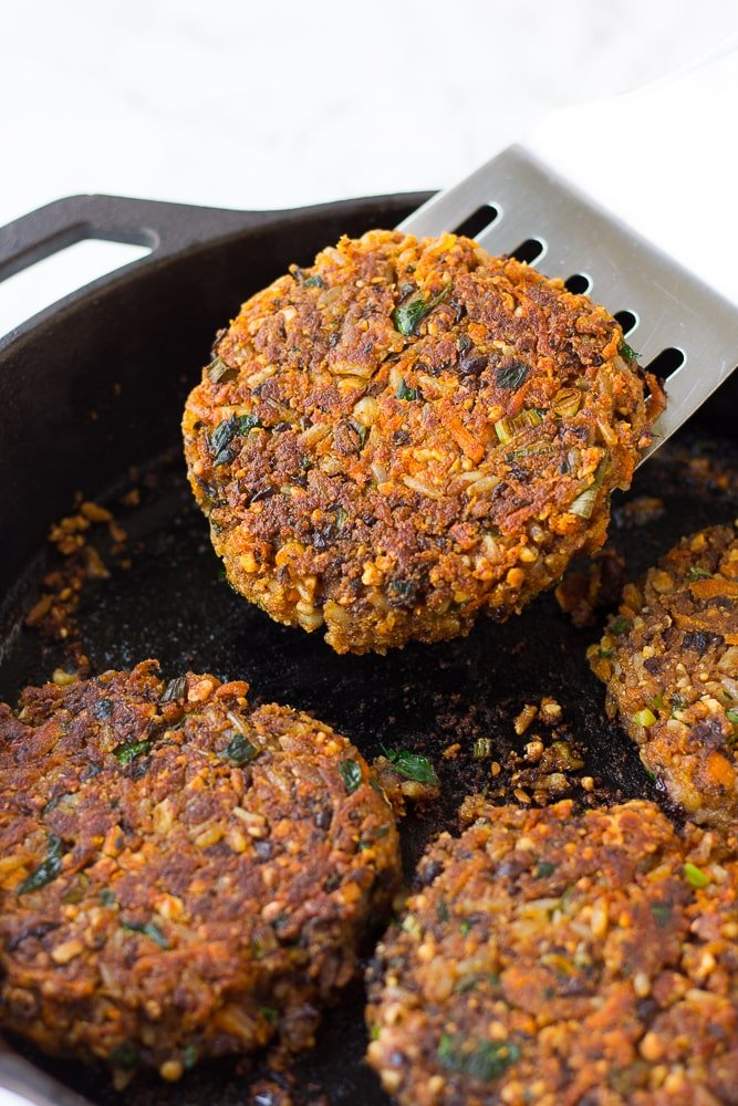 veggie burger being lifted out of a pan