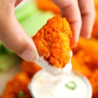 square image of a piece of buffalo cauliflower being dipped into ranch