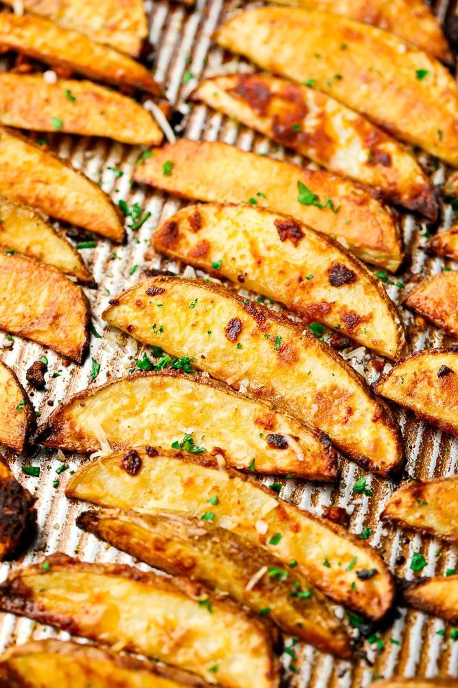 crispy potato wedges on a pan