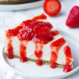 piece of vegan cheesecake with strawberry sauce