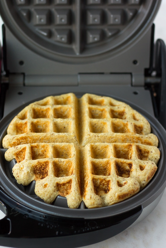 vegan waffle being cooked in waffle maker