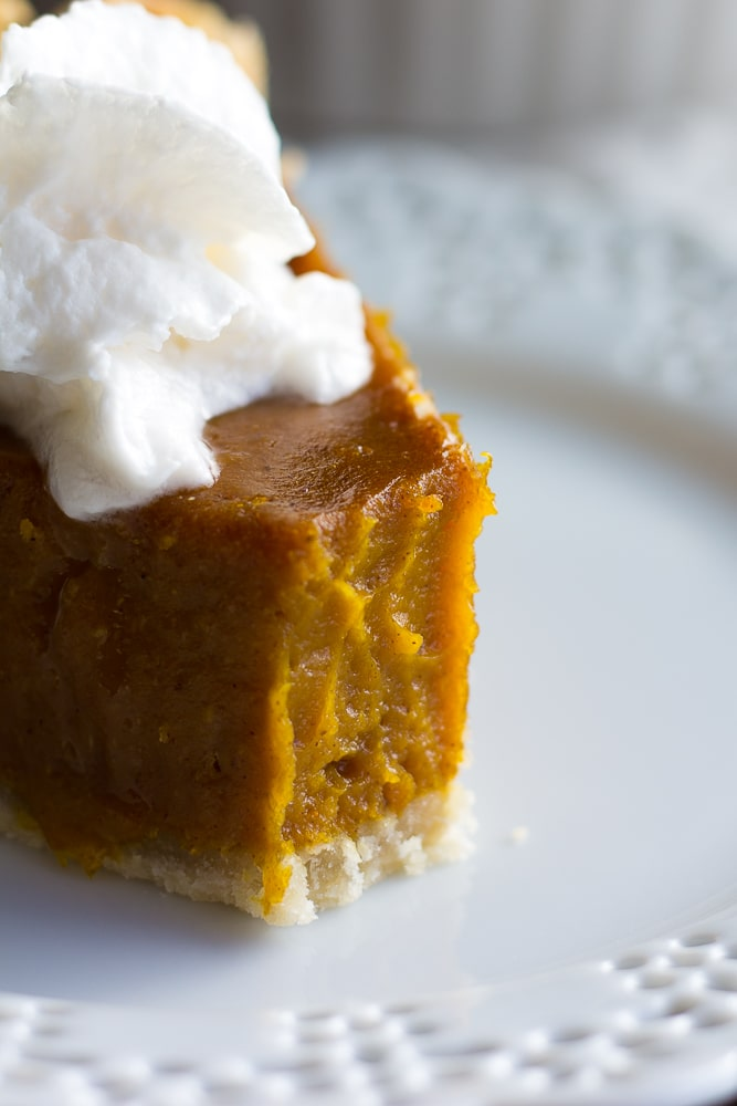 vegan pumpkin pie with a bite taken out of it, close up.
