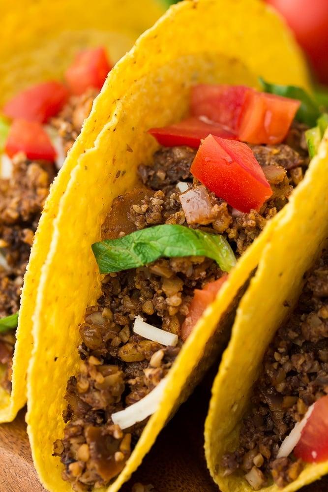 close up of 3 vegan tacos close together