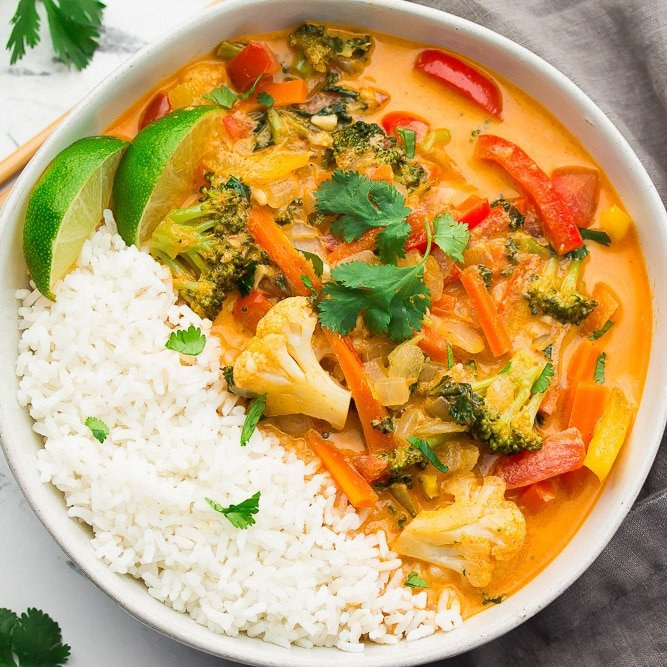 square image of a bowl of red curry with rice