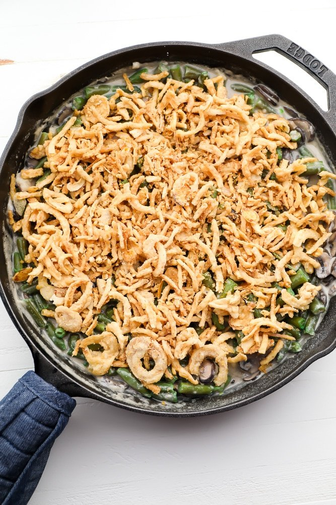 uncooked green bean dish in cast iron pan